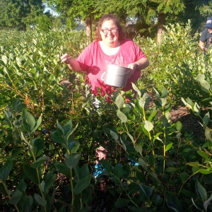 Amber Perry, volunteer gleaner, working at Creswell Blueberries. Photo courtesy of Brandy Collier.